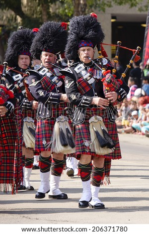 EDMONTON, AB, CANADA-July 18, 2014:  Bagpipers as seen in the K-Days Parade on July 18th, 2014.  - stock photo