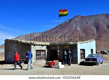 EDUARDO AVAROA NATIONAL RESERVE OF ANDEAN FAUNA, BOLIVIA - AUGUST 30, 2014: Unidentified tourists waiting for their passports control at the bolivian border checkpoint, Bolivia - stock photo