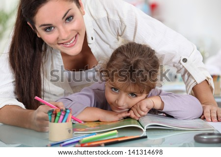 Educating young girl - stock photo