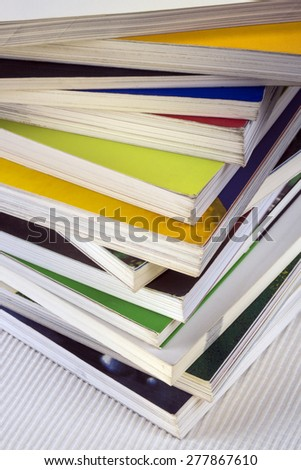 Education - A stack of well used college textbooks - stock photo