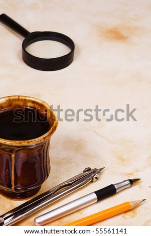 education accessory and coffee at paper - stock photo