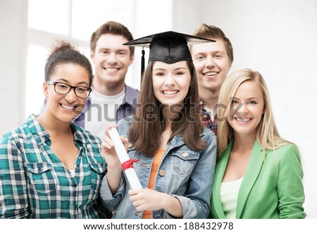 education and competition concept - girl in graduation cap with certificate and students