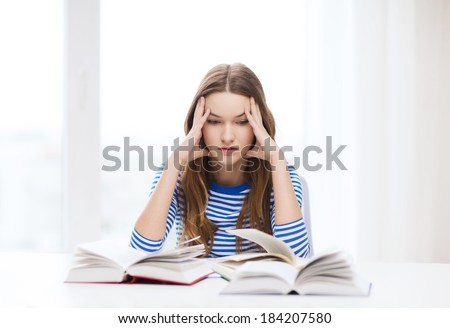 education and home concept - stressed student girl with books - stock photo