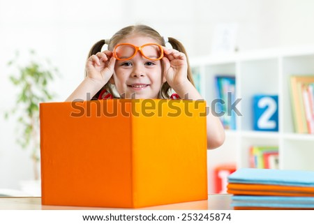 Education and learning concept. Happy kid girl with books - stock photo