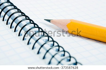 Education and objects. Blank notebook with pencil - stock photo