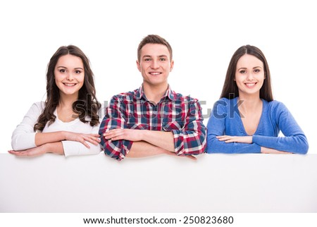 Education and people concept. Group of smiling students are sitting over white background.