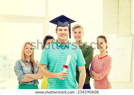 education and people concept - smiling male student with diploma and corner-cap and friends on the back - stock photo