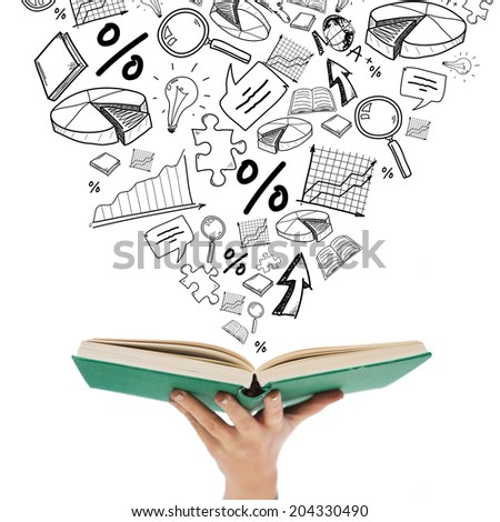 education and reading concept - close up of woman hand holding open green book with doodles - stock photo