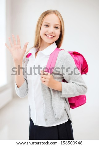 education and school concept - happy and smiling teenage girl with school bag - stock photo