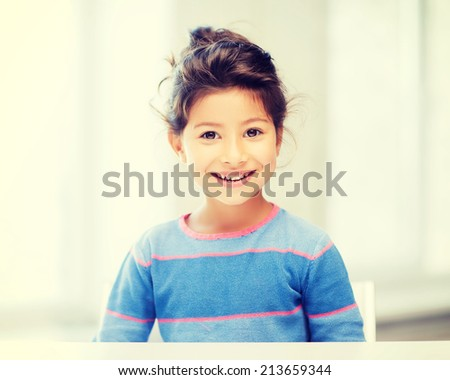 education and school concept - little student girl at school - stock photo