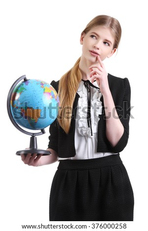 education and school concept - little student girl studying geography with globe