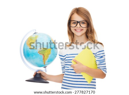 education and school concept - smiling little student girl with globe, notebook and black eyeglasses - stock photo