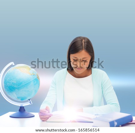 education and school, travel concept - female teacher with globe and book - stock photo