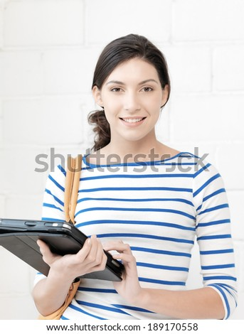education and technology concept - picture of happy teenage girl with tablet pc computer - stock photo