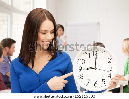 education and time management concept - attractive student showing clock - stock photo