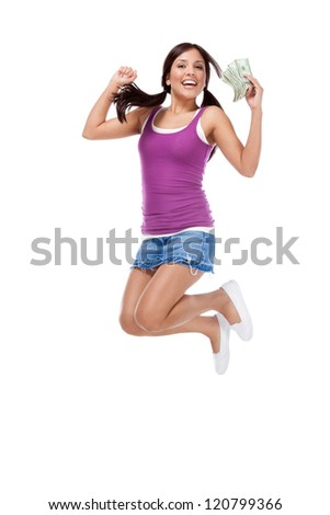 education back to school series - Friendly ethnic Latina woman high school student with pile of 100 dollars money bills in jeans skirt jumping in excitement