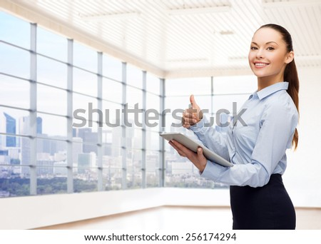 education, business and technology concept - smiling businesswoman or student with tablet pc computer over office room or new apartment background - stock photo