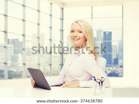 education, business and technology concept - smiling businesswoman or student with tablet pc computer over office room and city view in window - stock photo