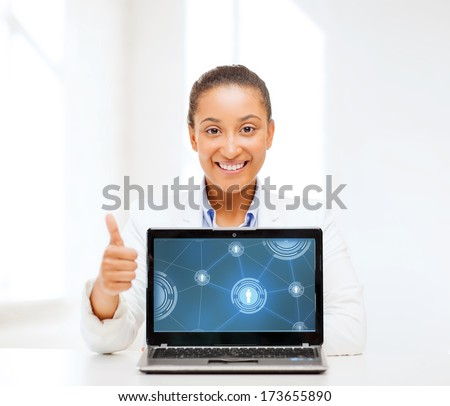 education,business, technology and internet concept - smiling woman with laptop computer - stock photo