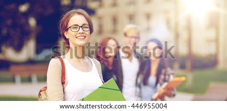 education, campus, friendship and people concept - group of happy teenage students with school folders - stock photo