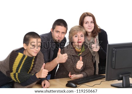 Education, Caucasian students and teacher with thumbs up and computer