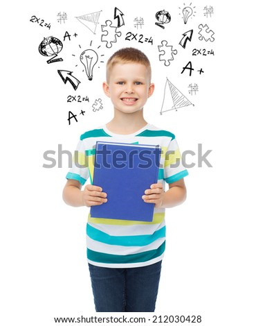 education, childhood and school concept - smiling little student boy with blue book - stock photo