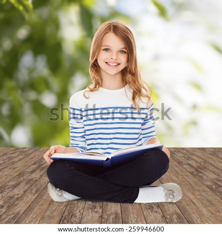 education, childhood, people and school concept - little student girl studying and reading book over greed background - stock photo