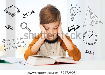 education, childhood, people, homework and school concept - bored student boy reading book or textbook at home over mathematical doodles - stock photo