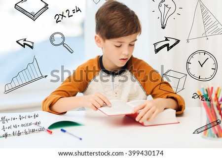 education, childhood, people, homework and school concept - student boy reading book or textbook at home over mathematical doodles - stock photo
