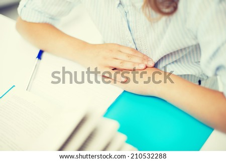 education, children and school concept - little student girl studying - stock photo