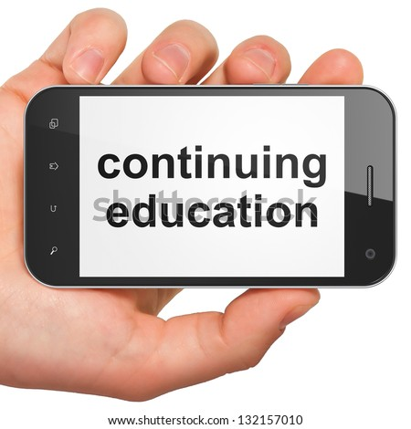 Education concept: hand holding smartphone with word Continuing Education on display. Generic mobile smart phone in hand on White background. - stock photo