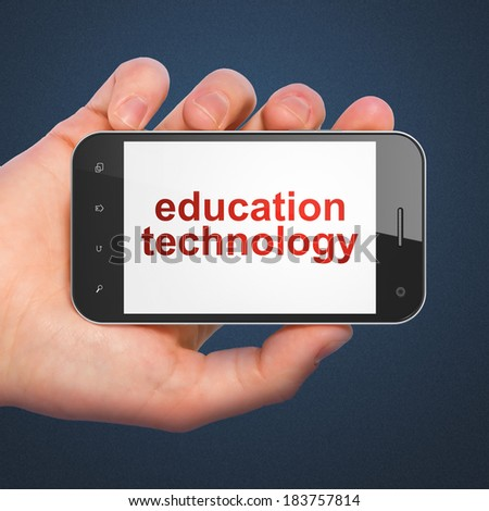 Education concept: hand holding smartphone with word Education Technology on display. Mobile smart phone on Blue background, 3d render - stock photo