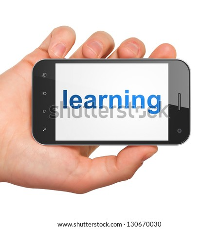 Education concept: hand holding smartphone with word Learning on display. Generic mobile smart phone in hand on White background.