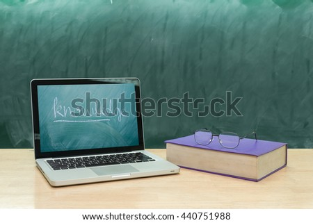 education concept,knowledge font on laptop and glasses above book on classroom,education online concept - stock photo