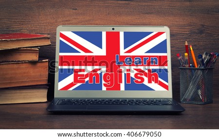 Education concept. learn english online. Laptop, books and school supplies. - stock photo