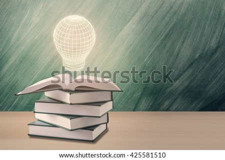 education concept,light box over open book with green chalkboard - stock photo