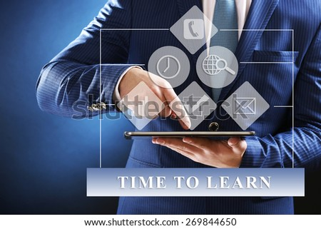 Education concept. Male hand touching screen tablet close-up - stock photo