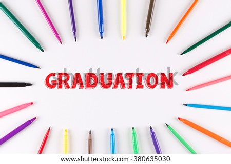 EDUCATION CONCEPT: Multi Colored Pen written GRADUATION - stock photo