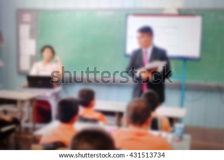 Education concept on blurred students in classroom with teachers and school director. Classroom students. Primary students. School director. Primary school kid. Free education. Team teaching. - stock photo