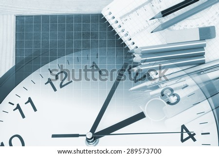 Education concept, school supplies and clock - stock photo