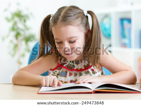 education concept - smiling little student kid reading book at home - stock photo