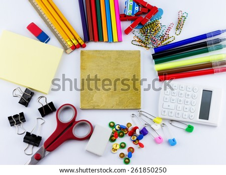 Education concept. Top view of blank board with school and office supplies on white background - stock photo