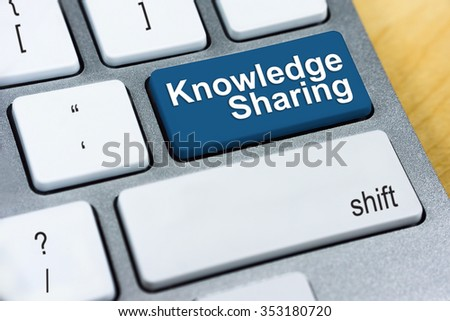 Education concept: Written word Knowledge Sharing on blue keyboard button. - stock photo
