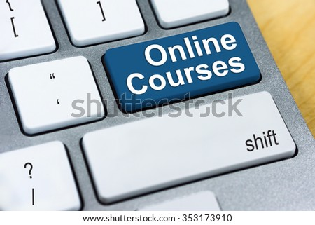 Education concept: Written word Online Courses on blue keyboard button.