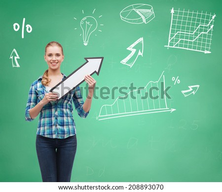 education, direction and people concept - smiling student girl with white arrow pointing up over green board background