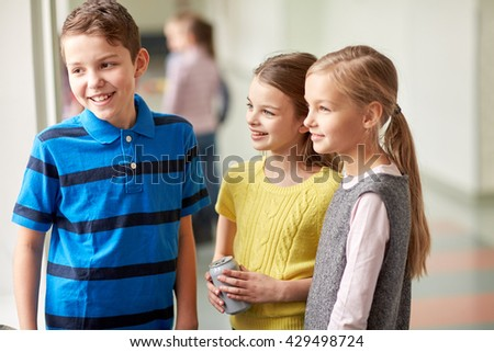 education, elementary school, children, break and people concept - group of smiling school kids talking in corridor - stock photo