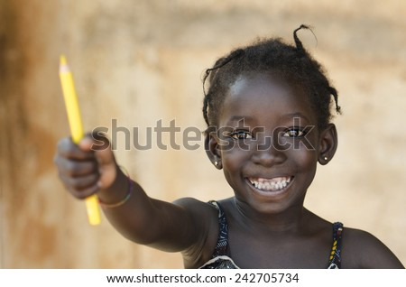 Education for Africa Symbol: Beautiful Young Schoolgirl Toothy Smile  - stock photo