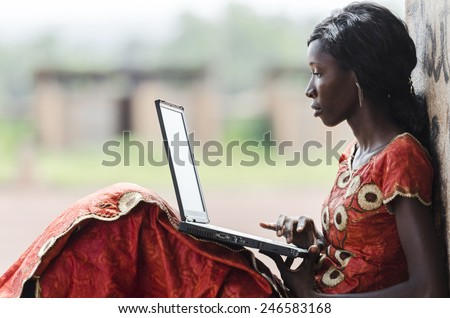Education for Africa: Technology Symbol African Woman Studying Learning Lesson - stock photo