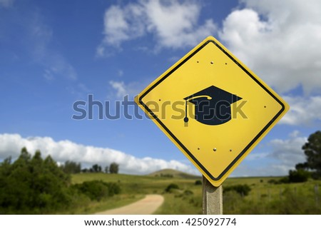 Education for all people, access to schools in rural zone concept. Road sign with graduation cap icon on natural environment, includes copy space. - stock photo