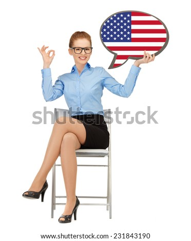 education, foreign language, english, people and communication concept - smiling woman holding text bubble of american flag and showing ok gesture - stock photo